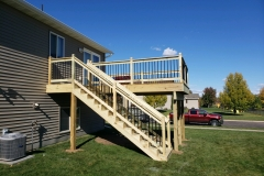 Treated-Wood-Deck-with-Black-Aluminum-Spindles