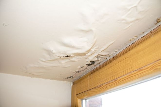Picture of moisture damaged ceiling.